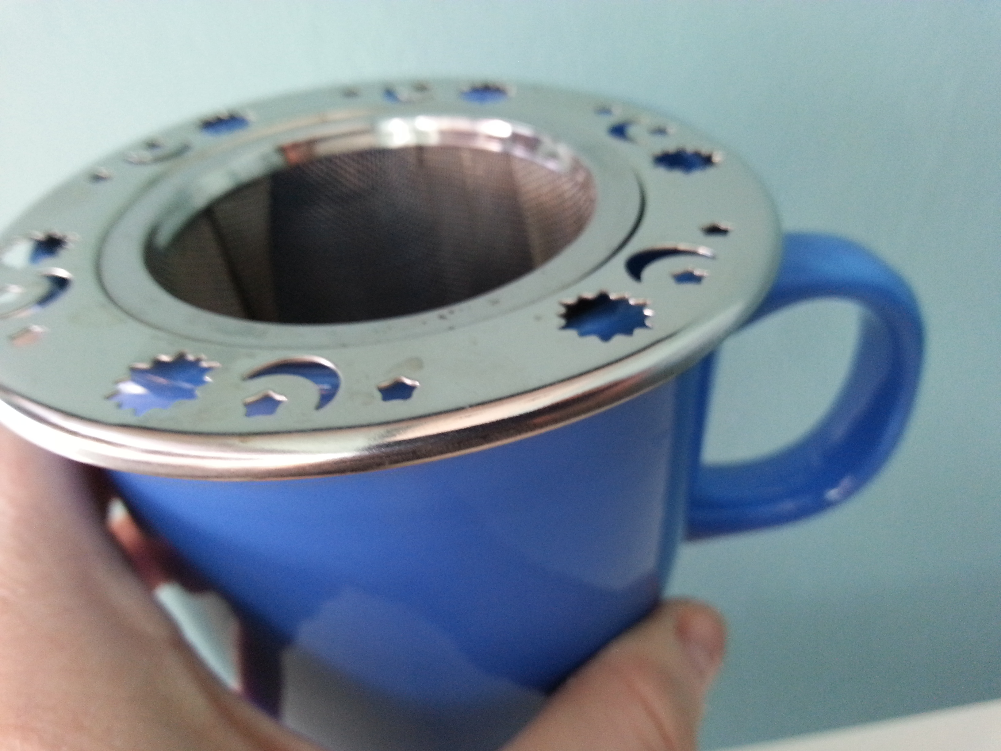 celestial tea strainer sits right inside your favorite tea cup